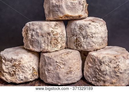 French Cheese Crottin De Chavignol In The Dark Background. High Quality Photo
