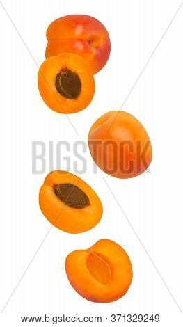 Flowing Apricot Fruits Isolated On White Background With Shallow Depth Of Field