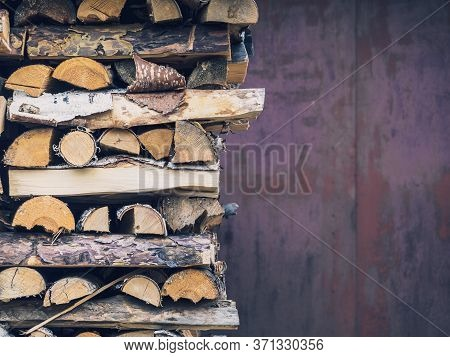 Birch Wood Neatly Stacked In A Woodpile, Close-up, Copy Space. Preparation Of Firewood And Boards On