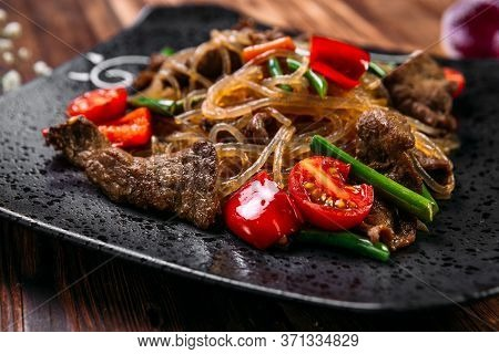Closeup On Appetizing Korean Salad Funchoza With Beef Starch Noodles And Vegetables, Horizontal