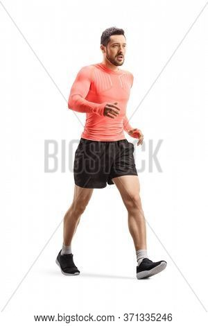 Full length shot of a fit young man in sportswear walking fast isolated on white background