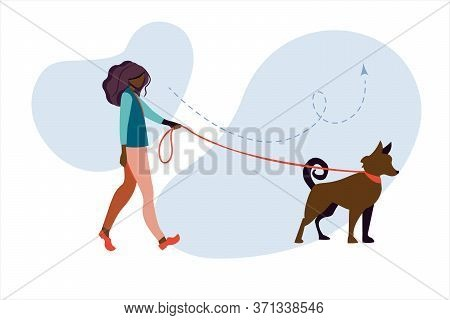 Young African Woman Walks In The Park With A Dog. Young African American Woman Walking A Dog On The