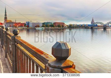 View Of Riga City Frome Stone Bridge, Riga, Latvia. St. Peter Church Left , Latvian Academy Of Scien