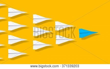 Blue Paper Plane Leading Group Of White Paper Planes On Orange Background, Business Concept For Lead