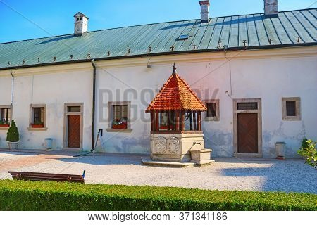 Well On The Yard In The Red Stone Castle Near The Settlement Called Pila In Slovakia, Europe