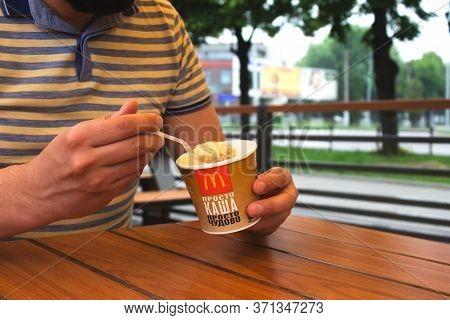 Lviv, Ukraine - June 14, 2020 : Man Having Oatmeal For Breakfast At Mcdonalds Restaurant - One Of Th