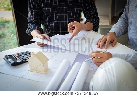 Engineers or architects are meeting a team to design the architectural structure in the design with
