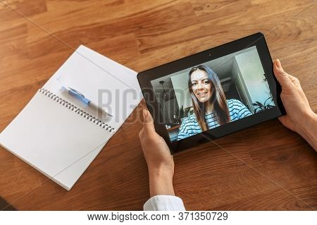 Video Call, Video Meeting Of Two Persons. A Young Woman On The Tablet Screen, Two Women Communicate