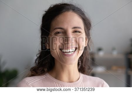 Head Shot Portrait Laughing Overjoyed Beautiful Woman Looking At Camera