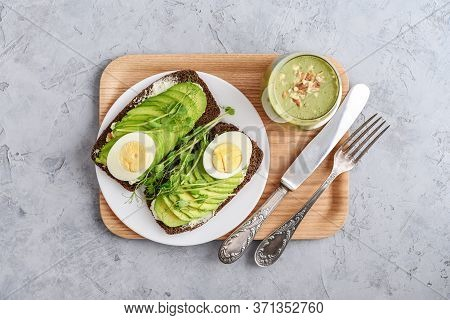 Avocado Sandwich With Boiled Egg - Sliced Avocado And Egg On Rye Toasted Bread For Healthy Breakfast
