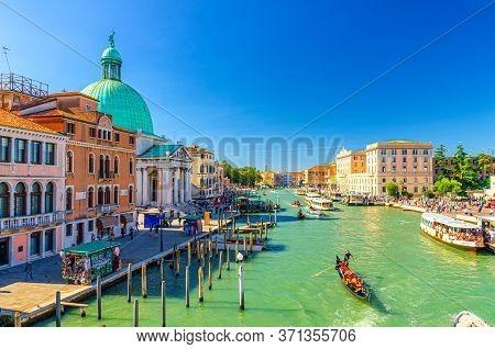 Venice, Italy, September 13, 2019: Venetian Cityscape With Yachts, Gondolas And Vaporettos Sailing G