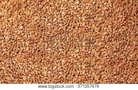 Background Of Raw Buckwheat Cereals From Above
