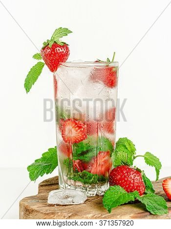 Detox Water With Strawberries, Soda, Ice And Mint Leaves. Healthy Lifestyle.