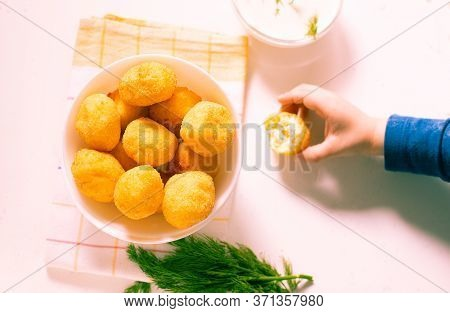 Child Taking A Syrniki A Small Homemade Pancakes Fried In Oil, To Eat It