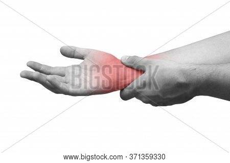 Man Suffering From Wrist Pain, Isolated, Black And White Photo. Causes Of Pain Include Sprained Wris