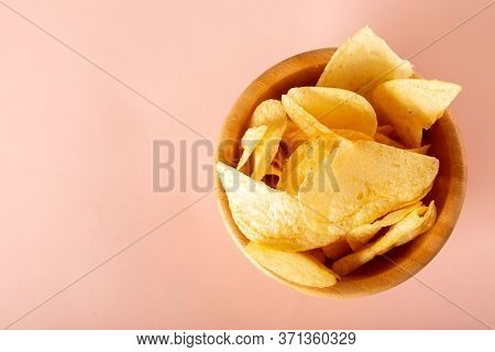Potato Chips In A Bowl On Pink Background