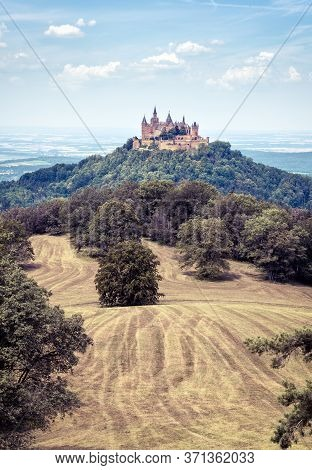 Hohenzollern Castle Or Burg Atop Mount In Summer, Germany. Famous Old Gothic Castle Is Landmark In B