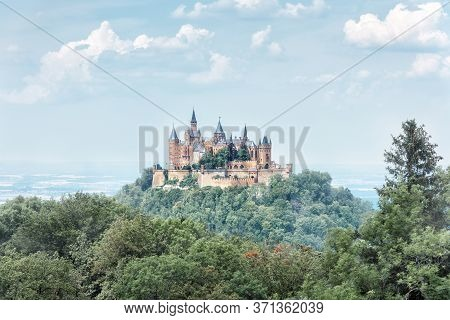 Landscape Of Misty Mountain With Gothic Hohenzollern Castle In Summer Morning, Germany. Old Burg Hoh