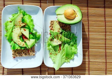 Toast To The Avocado. Healthy Avocado Toast. Top View Of The Table. Healthy Food, Vegetarian Food Co