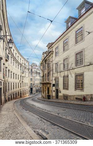 Narrow Cobblestone Streets Of The Chiado District In Lisbon, Portugal