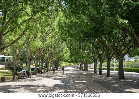 Lisbon, Portugal - July 5, 2019: People Are  Relaxing In Eduardo Vii Park In Lisbon In A Beautiful S