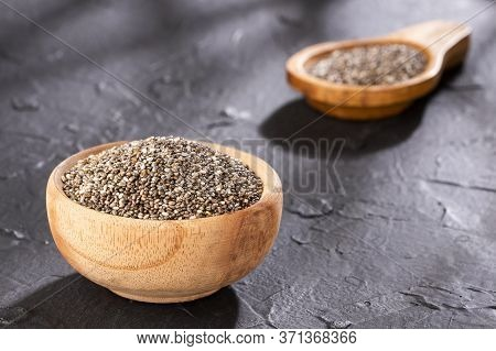 Healthy Chia Seeds In Wooden Bowl - Salvia Hispanica