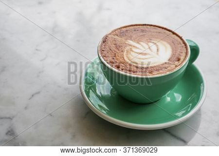 A Cup Of Coffee With Latte Art On Top On Light Background, Closeup