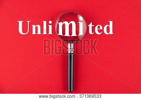 Unlimited Text Written On A Magnifying Glass Background. Business Concept. Education.