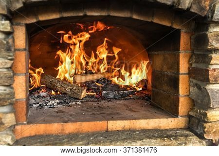 Old Stone Homemade Pizza Oven. Fire In The Furnace. Homemade Baking Pizza. Bakery. Traditional Itali