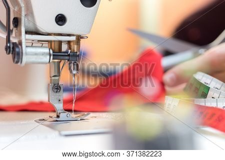 Sewing In A Tailor Workshop: Close Up Picture Of Sewing Needle