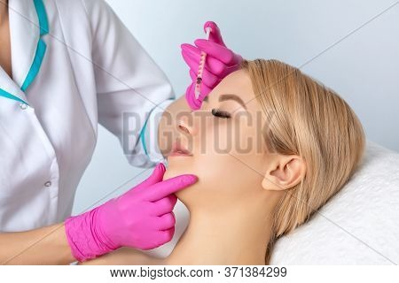 The Doctor Corrects A Small Hump On The Nose. Plastic Surgery, The Surgeon Makes Rhinoplasty Of The