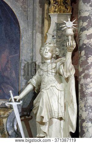 ZAGREB, CROATIA - NOVEMBER 12, 2012: Saint Barbara statue on the main altar in the Franciscan church of St. Francis Xavier in Zagreb, Croatia