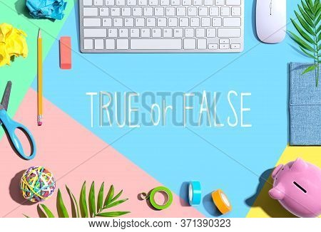 True Or False With Office Supplies And A Computer Keyboard