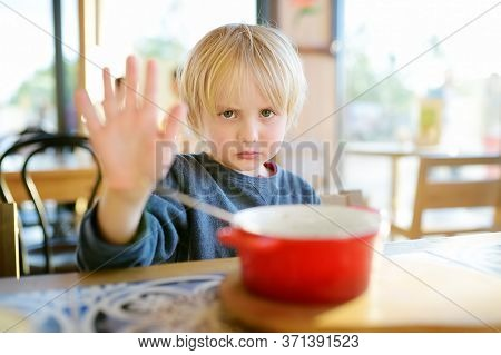 Little Boy Sitting The Table In Cafe Or Restaurant And Doesn't Want To Eat. Healthy Food. Kids Diet.