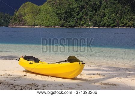 Yellow Kayak Isolated On Sand, On The Beach Of Exotic Tropical Travel Destination Pasumpahan Island,