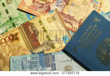 Dubai / Uae - June 10, 2020: Background Made Of Kazakhstan National Currency With Passport, Top View