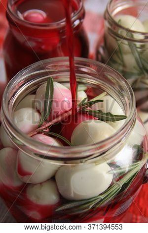 Marinated Quail Eggs In Jars. Preparing Quail Eggs Delicacy For Easter, With Beetroot, Vinegar, Rose