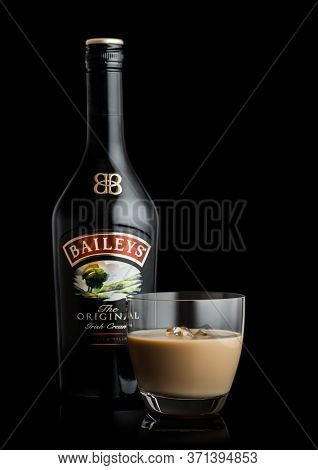London, Uk - June 02, 2020: Bottle And Glass Of Baileys Original Irish Cream On Black Background. Ir