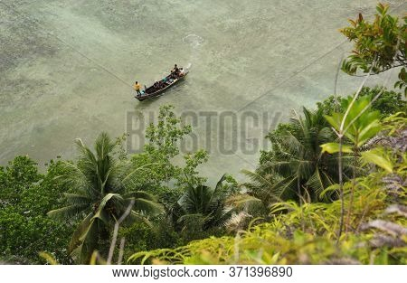 People On Boat Approaching Shore In Tropical Sea Destination Island Pasumpahan Island, Padang, West