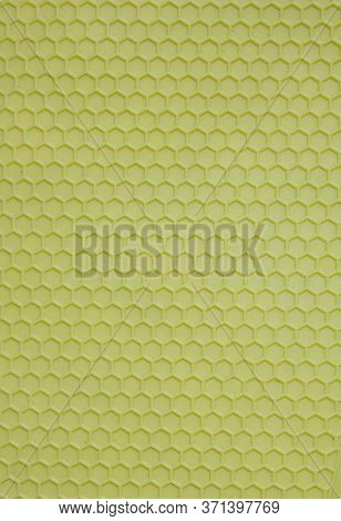 Plastic Background In The Form Of Salad-colored Honeycombs. Textured Corrugated Background Of Salad