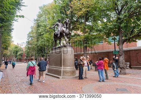 Boston Usa - October 14 2014; Tourists Below Bronze Statue Of Paul Revere In Boston's Northend Distr