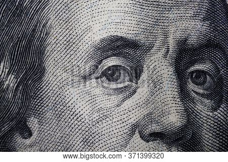 100 Dolar Usa Close Up. Franklin Eyes Macro. The Texture Of The Fragment Of The Dollar Bill. Usd Ban