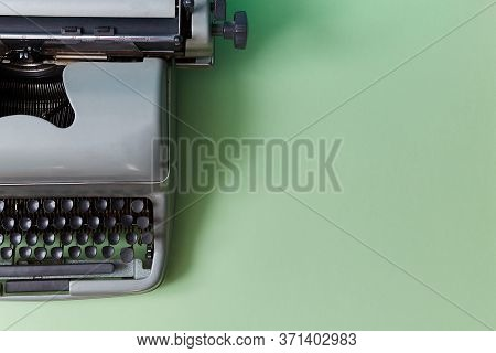 Retro Typewriter On Green Background. Authorship. Journalism. Manual Machine With Keys For Typewriti