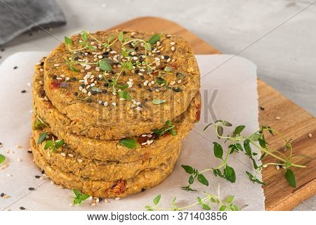 Raw Veggie Burger With Lentils, Vegetables And Thyme Leaves On Kitchen Countertop. Top View. Flat La