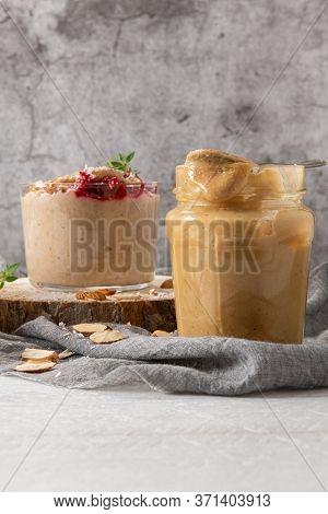 Breakfast Oatmeal Porridge With Raspberries, Almond, Cinnamon, Almond Butter And Coconut. Healthy Br
