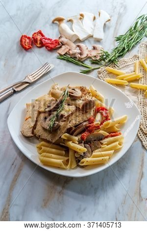 Creamy Italian Chicken Marsala With King Oyster Mushrooms And Sundried Tomatoes Served Over Penne Ri