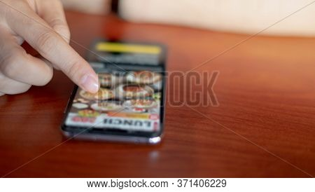 Female Hand Scanning The Qr Code With Mobile Phone For Order Foods And Pay At The Restaurant For The