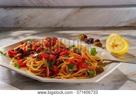 Delicious Italian Spaghetti Alla Puttanesca With Kalamata Olives And Capers