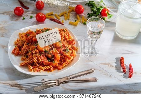 Gluten-free Fusilli Pasta In Creamy Vodka Tomato Sauce With Sausage Shrimp And Green Peas