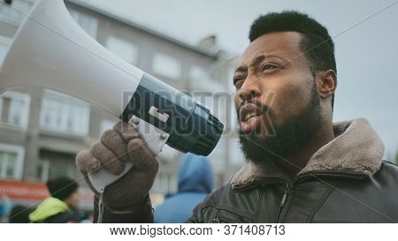 African American Man Hold Megaphone Hand. Shout Out. Political Rally. Social Activists Speack Outdoo